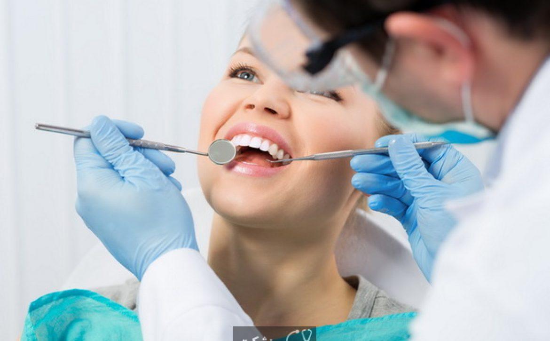 Regular dentist visit. Caries cure. Young woman visiting dentist